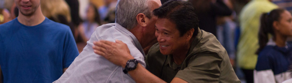 father and son rejoicing after getting verdict
